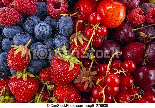 Fresh mixed summer berries - raspberry, strawberry, blueberry - csp91276938