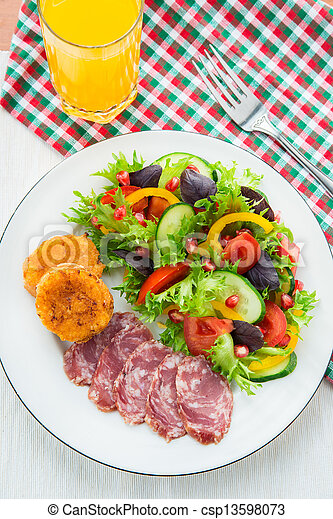 Fresh mixed vegetable salad, sliced sausage and cheese toasts - csp13598073