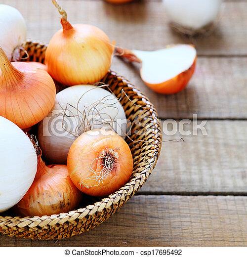 fresh onions in a basket - csp17695492