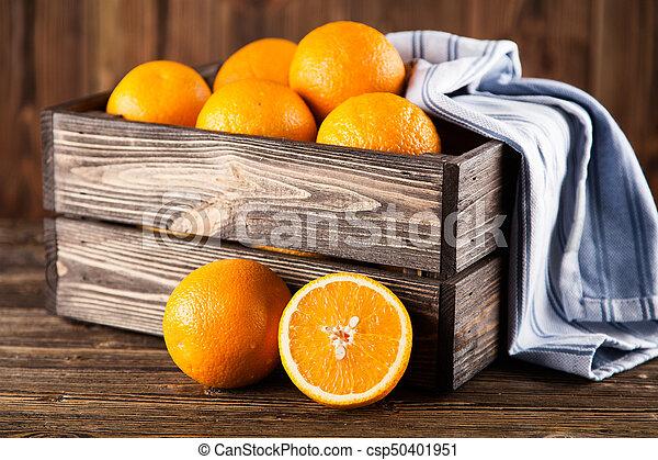 Fresh oranges in a crate - csp50401951