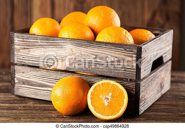 Fresh oranges in a crate - csp49864928