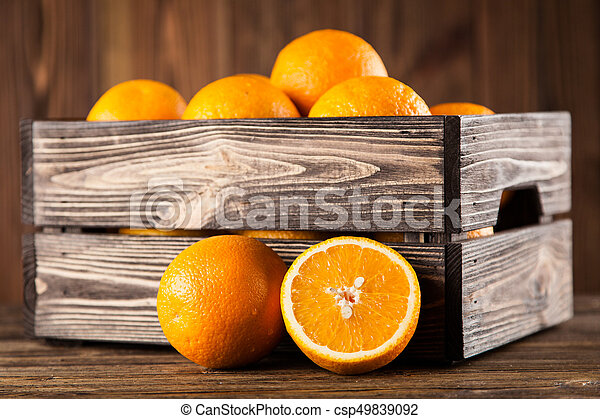 Fresh oranges in a crate - csp49839092