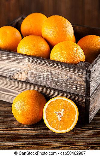 Fresh oranges in a crate - csp50462907