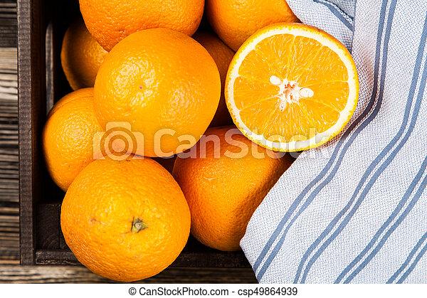 Fresh oranges in a crate - csp49864939