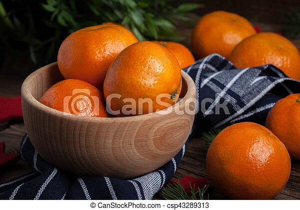 Fresh oranges in wooden bowl. - csp43289313
