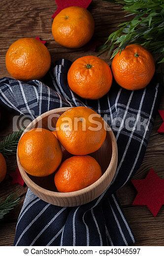 Fresh oranges in wooden bowl. - csp43046597
