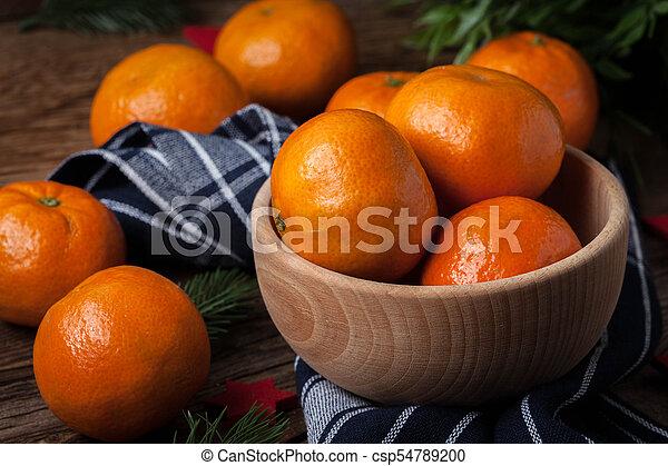 Fresh oranges in wooden bowl. - csp54789200