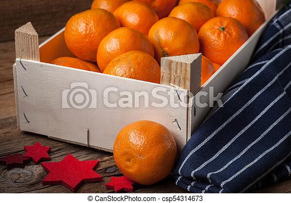 Fresh oranges in wooden box - csp54314673