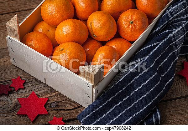 Fresh oranges in wooden box - csp47908242