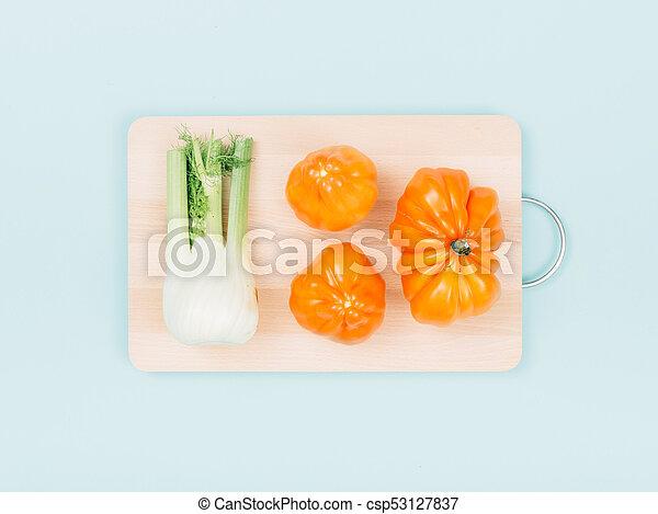 Fresh organic vegetables on a chopping board - csp53127837