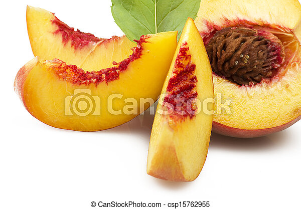 Fresh peach fruits with cut and green leaves on white background - csp15762955