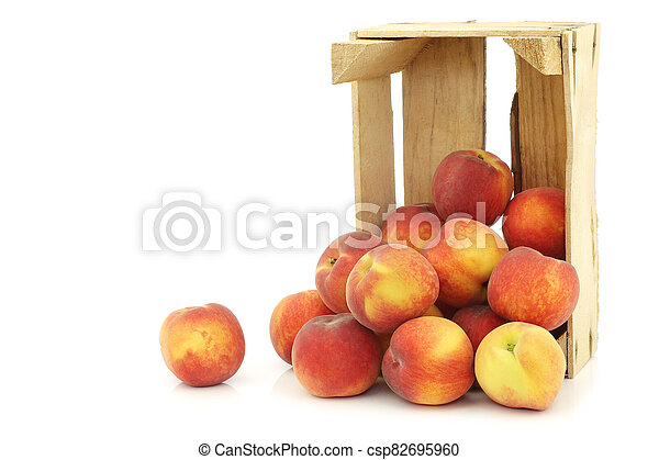 Fresh peaches in a wooden crate - csp82695960