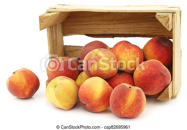 Fresh peaches in a wooden crate - csp82695961