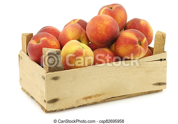 Fresh peaches in a wooden crate - csp82695958