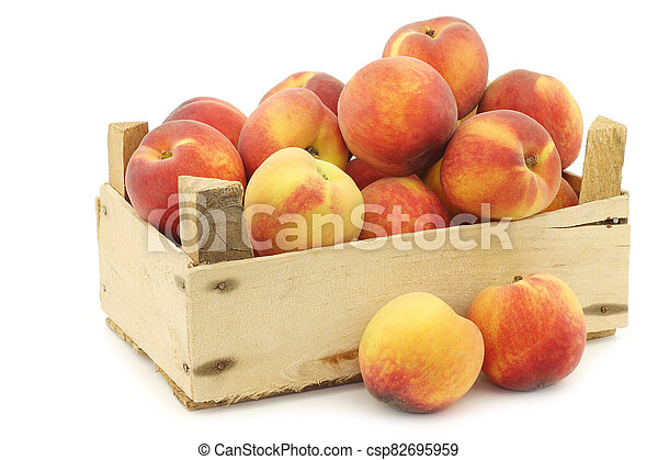 Fresh peaches in a wooden crate - csp82695959