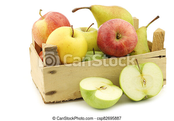 Fresh pears and apples in a wooden crate - csp82695887