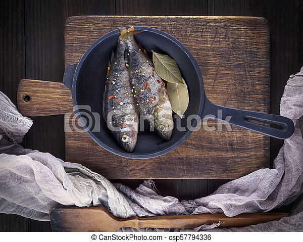 fresh peeled fish from scales with spices - csp57794336