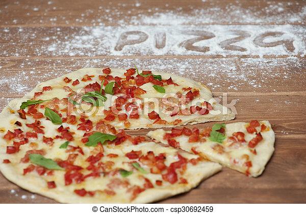 fresh pizza margarita on a wooden plate  - csp30692459