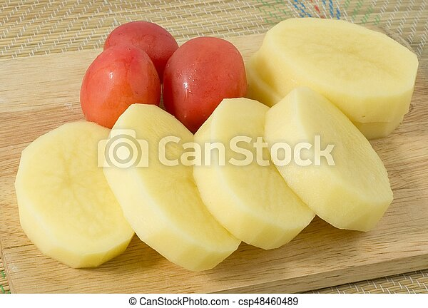Fresh Potatoes and Tomatoes on Wooden Board - csp48460489