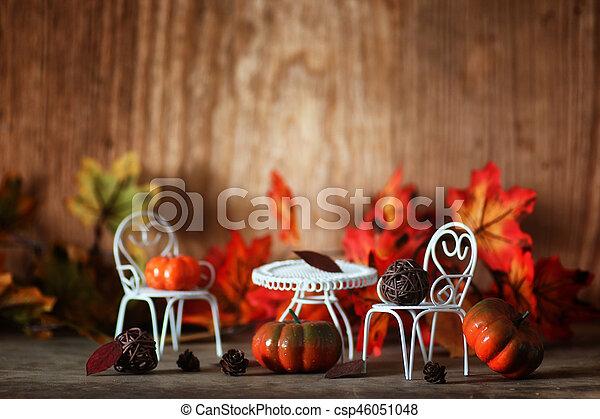 fresh pumpkin in interior wooden room on chair - csp46051048