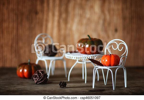 fresh pumpkin in interior wooden room on chair - csp46051097