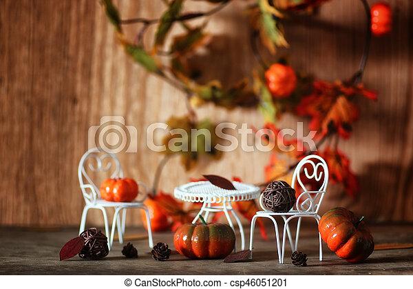 fresh pumpkin in interior wooden room on chair - csp46051201