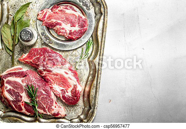 Fresh raw beef meat with spices and herbs. - csp56957477