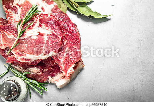 Fresh raw beef meat with spices and herbs. - csp56957510