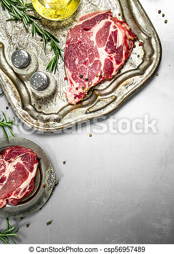 Fresh raw beef meat with spices and herbs. - csp56957489