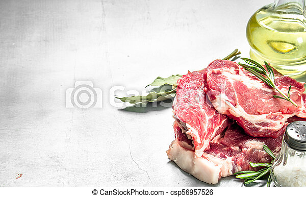Fresh raw beef meat with spices and herbs. - csp56957526