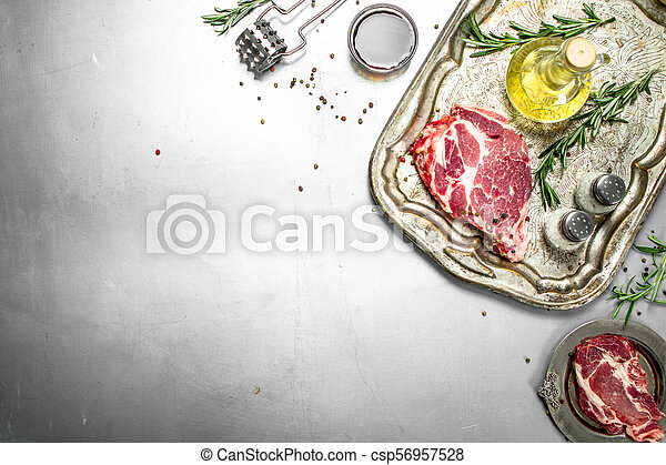 Fresh raw beef meat with spices and herbs. - csp56957528