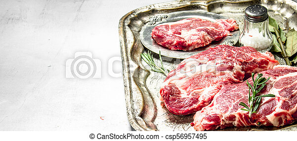 Fresh raw beef meat with spices and herbs. - csp56957495