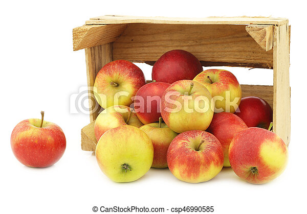 Fresh red and yellow apples in a wooden crate - csp46990585