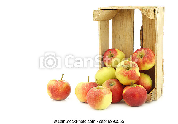 Fresh red and yellow apples in a wooden crate - csp46990565
