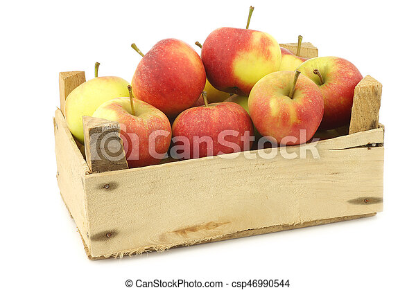 Fresh red and yellow apples in a wooden crate - csp46990544