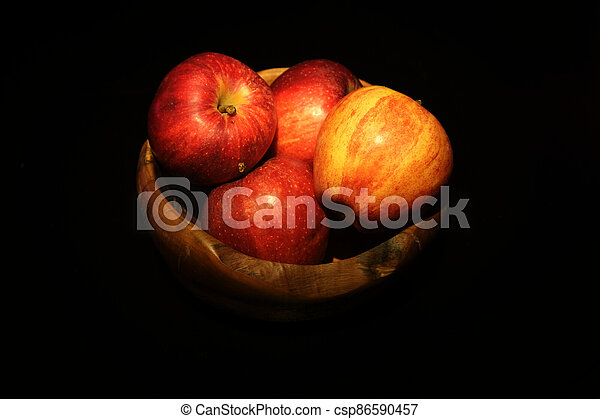Fresh red Apple in a wooden bowl - csp86590457
