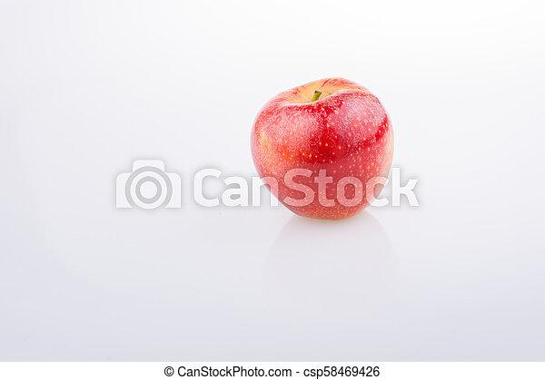 Fresh red apple on white background - csp58469426
