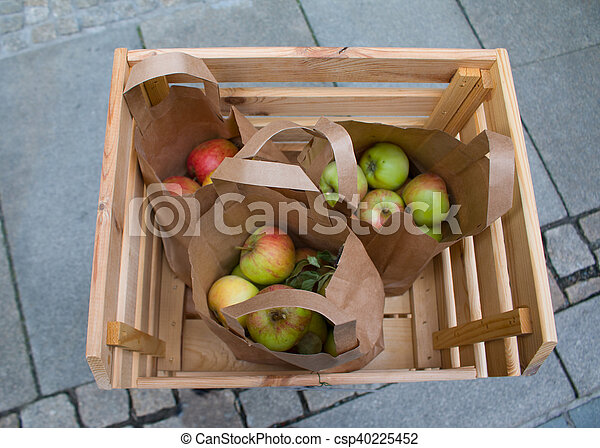Fresh red apples in a wooden . - csp40225452