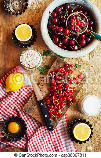 Fresh red cherries on a rustic wooden table. Ripe cherries i o - csp38067811