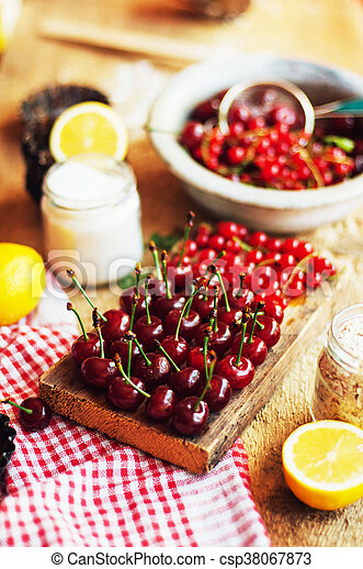 Fresh red cherries on a rustic wooden table. Ripe cherries i o - csp38067873