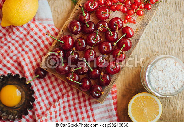 Fresh red cherries on a rustic wooden table. Ripe cherries i o - csp38240866
