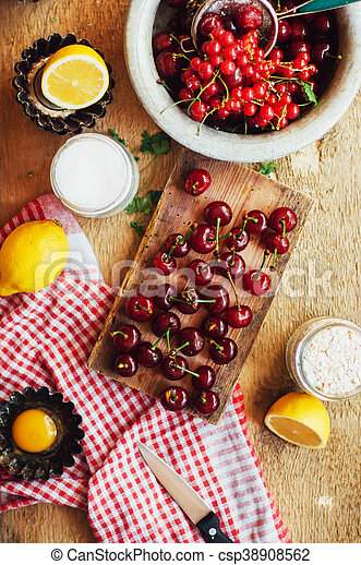 Fresh red cherries on a rustic wooden table. Ripe cherries i o - csp38908562