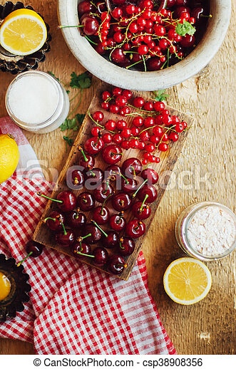 Fresh red cherries on a rustic wooden table. Ripe cherries i o - csp38908356
