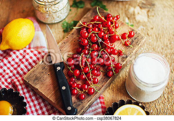 Fresh red cherries on a rustic wooden table. Ripe cherries i o - csp38067824