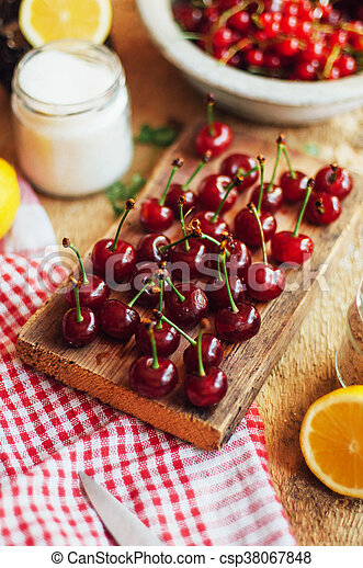 Fresh red cherries on a rustic wooden table. Ripe cherries i o - csp38067848
