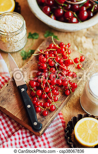 Fresh red cherries on a rustic wooden table. Ripe cherries i o - csp38067836