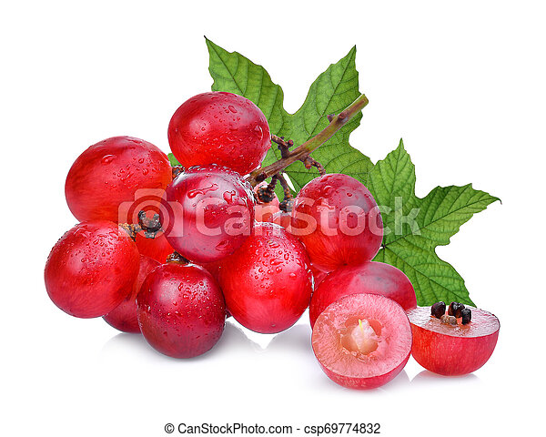 fresh red grapes with green leaves isolated on white background - csp69774832