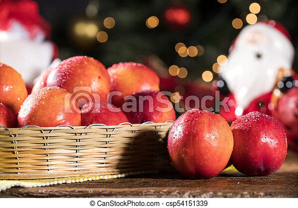 Fresh red nectarines in a wooden bowl. - csp54151339