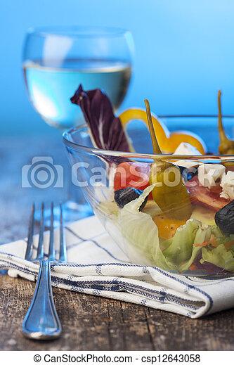 fresh salad in a glass bowl - csp12643058