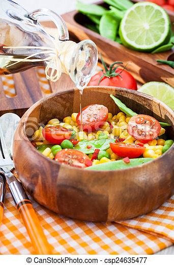 Fresh salad with corn, peas, tomato and chilli - csp24635477